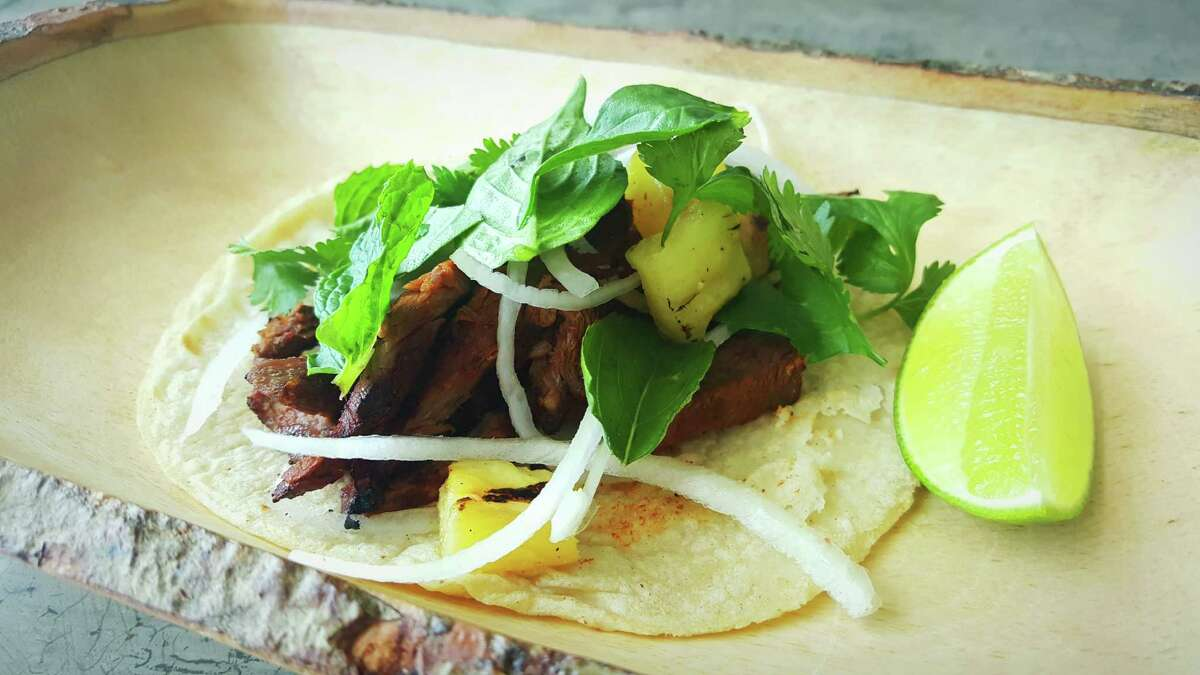 Venison pastor taco with grilled pineapple, onion, cilantro, mint and Thai basil on the new menu at Wooster's Garden from chef Brandon Silva.