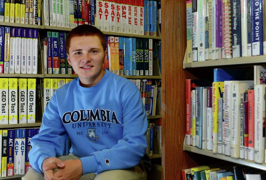 Brien McMahon High School graduate, Victor Borges, is pictured at the Norwalk Public Library on Friday. Borges will attend Columbia University this fall with help from a Gaffney Foundation scholarship. The Gaffney Foundation helps underprivileged but high-achieving students get accepted into colleges and get good financial aid packages. Photo: Erik Trautmann / Hearst Connecticut Media / (C)2016, Norwalk Hour, all rights reserved