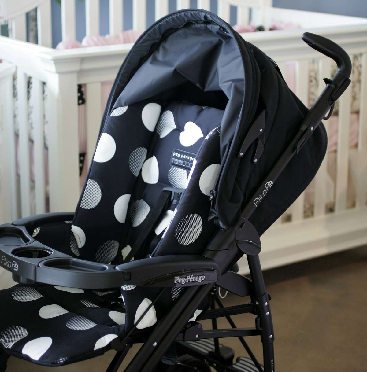 juliecooper Some mommies care only about style. The polka-dot fabric on this Peg Perego stroller at Kids' Rooms makes it one of the most popular strollers there. (Chris Oberholtz/Kansas City Star/MCT)