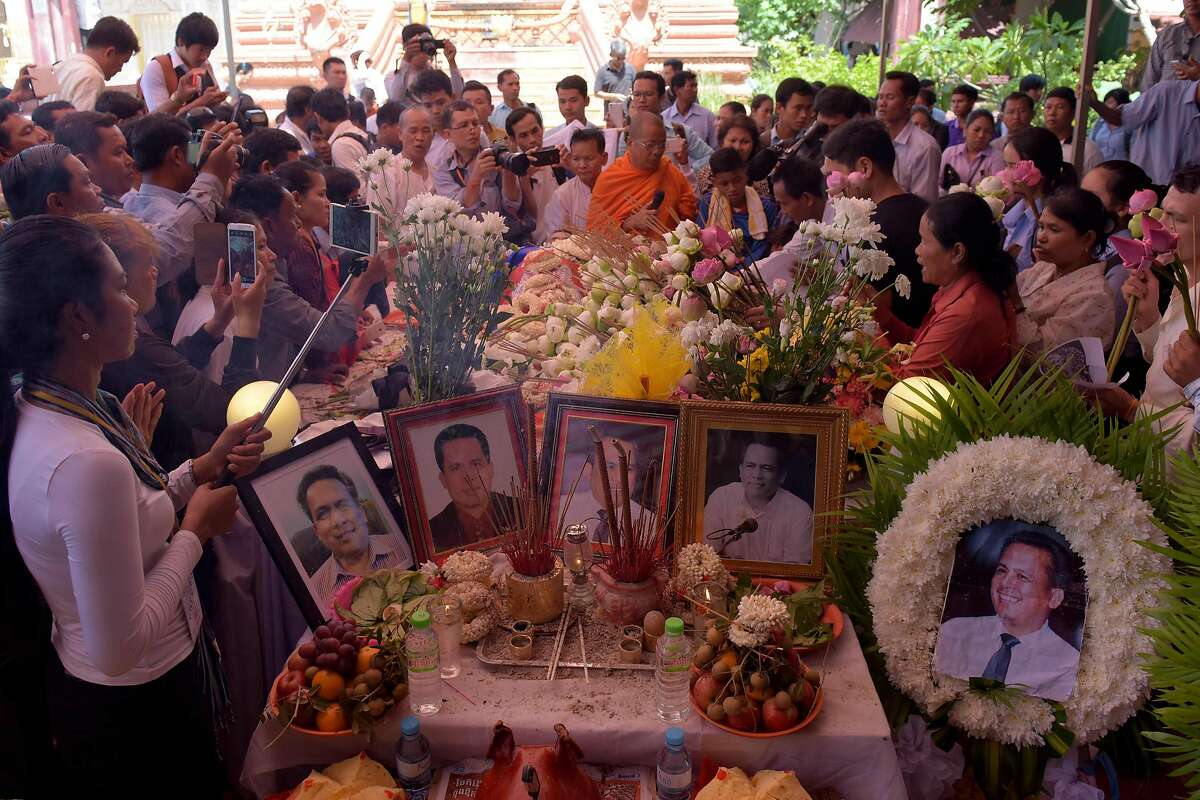 Cambodians pay their respects during a funeral ceremony for political analyst Kem Ley at a pagoda in Phnom Penh on July 11, 2016. Hundreds of mourners gathered for the funeral on July 11 of Kem Ley, a prominent Cambodian political commentator gunned down in broad daylight on July 10, as the country's premier vowed a thorough investigation. / AFP PHOTO / TANG CHHIN SOTHYTANG CHHIN SOTHY/AFP/Getty Images