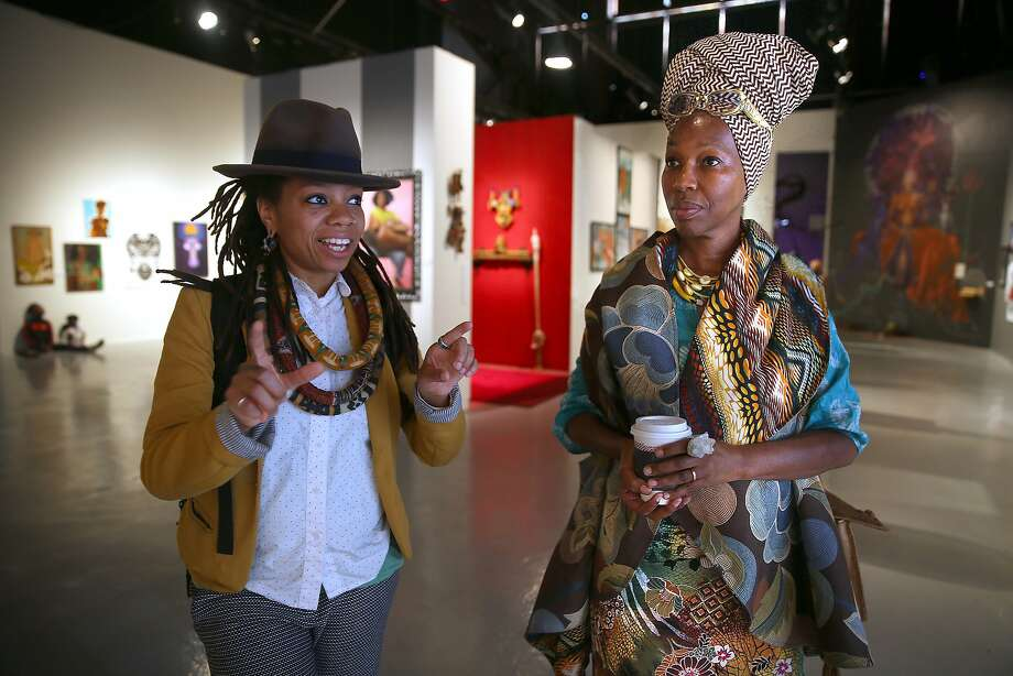 "Artists/curators Melorra Green (left) and Karen Seneferu (right) talk about the new ""The Black Woman is God"" exhibit at SOMArts on Friday, July 8, 2016, in San Francisco, Calif. Photo: Liz Hafalia, The Chronicle"