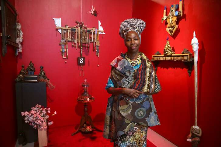 "Artist/curator Karen Seneferu shows her installation at the new ""The Black Woman is God"" exhibit at the SOMArts on Friday, July 8, 2016, in San Francisco, Calif."