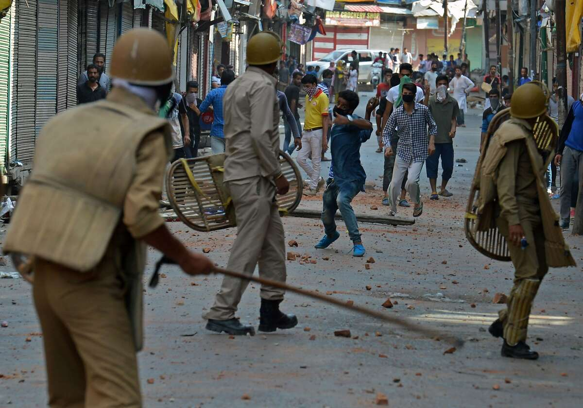 Indian police clash with Kashmiri protestors in Srinagar on July 11, 2016. Police said 30 people had now died in three days of clashes between Indian government forces and demonstrators angered by the killing of a popular young rebel. / AFP PHOTO / TAUSEEF MUSTAFATAUSEEF MUSTAFA/AFP/Getty Images