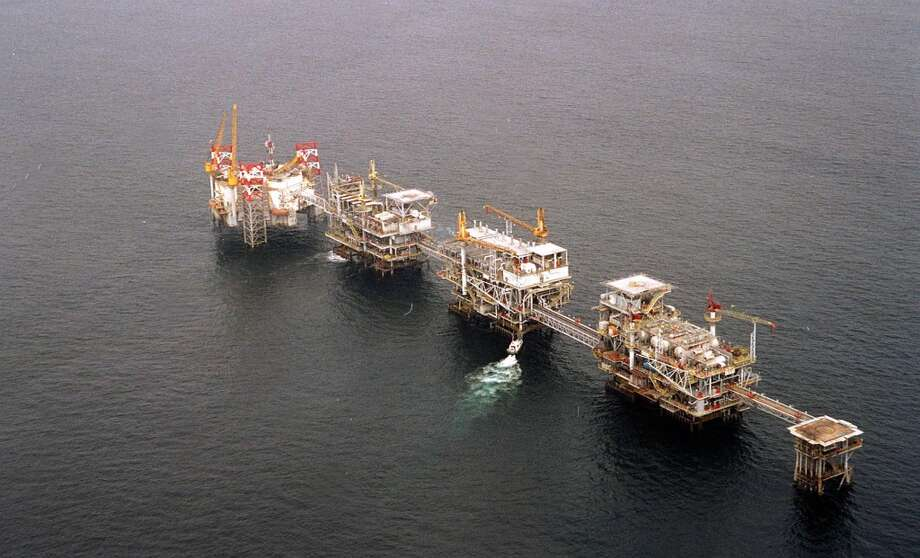A five-platform complex pumps crude off the coast of Cabinda, Angola's most prolific oil field. Photo: BRUCE STANLEY, AP