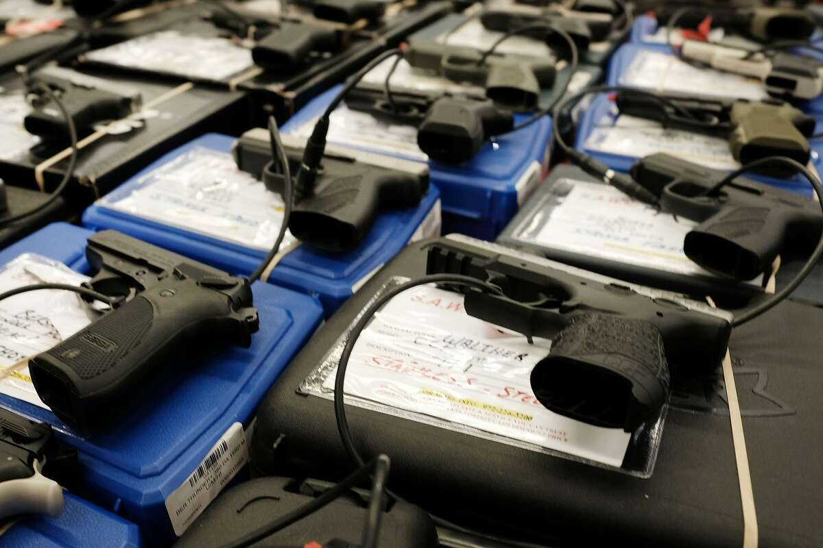 Guns sit for sale at a gun show where thousands of different weapons are displayed for sale on July 10, 2016, in Fort Worth, Texas. The area is still mourning the deaths of five Dallas police officers on Thursday evening, July 7, 2016, by a lone gunman.