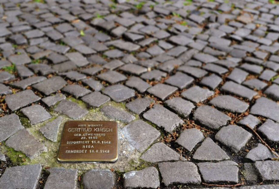Handmade plaques are in front of every other house on Guntzelstrasse, a main street in what had been a Jewish area of Berlin before World War II. Photo: Mike Wolff /Tagesspiegel / Stamford Advocate  contributed