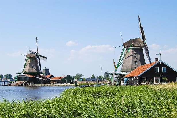 Holland's whirring windmills harness wind energy to pump excess water into canals.