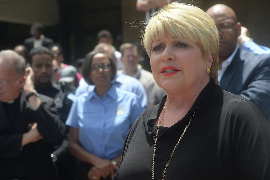 Beaumont Mayor Becky Ames offers her comments as members of the community gather at the headquarters Friday to observe a memorial service and prayer vigil in honor of the victims of the Dallas shooting Thursday night. Following incidents of two police shootings of black men, a Black Lives Matter rally turned deadly, as a sniper opened fire, targeting police. Photo taken Friday, July 8, 2016 Kim Brent/The Enterprise Photo: Kim Brent / Beaumont Enterprise
