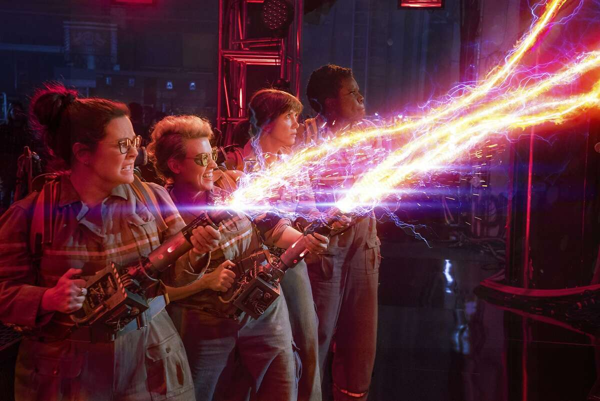"""In this image released by Sony Pictures, from left, Melissa McCarthy, Kate McKinnon, Kristen Wiig and Leslie Jones appear in a scene from, """"Ghostbusters."""" (Sony Pictures via AP)"""