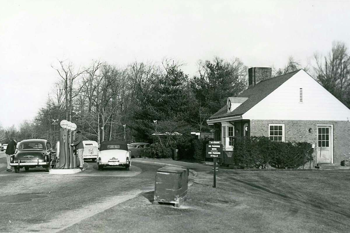 FAIRFIELD COUNTY, CT - Early-1950s: Drivers stop to get gas at a station along the Merritt Parkway, one of the oldest parkways in the United States. The portion from Greenwich to Norwalk, CT, was opened on June 29, 1938. The parkway is known for its scenic layout, its uniquely styled signage, and the architecturally elaborate overpasses along the route. (Photo by ISC Images & Archives via Getty Images)