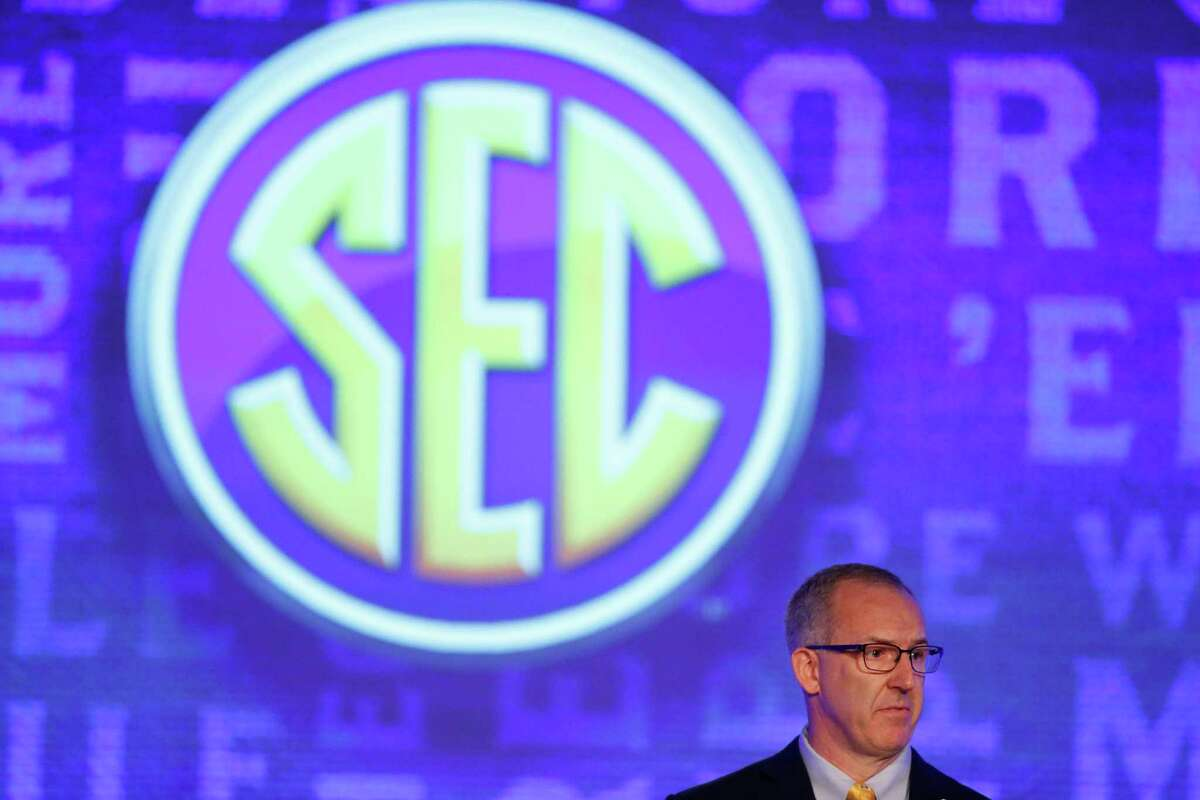 Southeastern Conference commissioner, Greg Sankey, speaks to the media at the Southeastern Conference NCAA college football media days, Monday, July 11, 2016, in Hoover, Ala. (AP Photo/Brynn Anderson)
