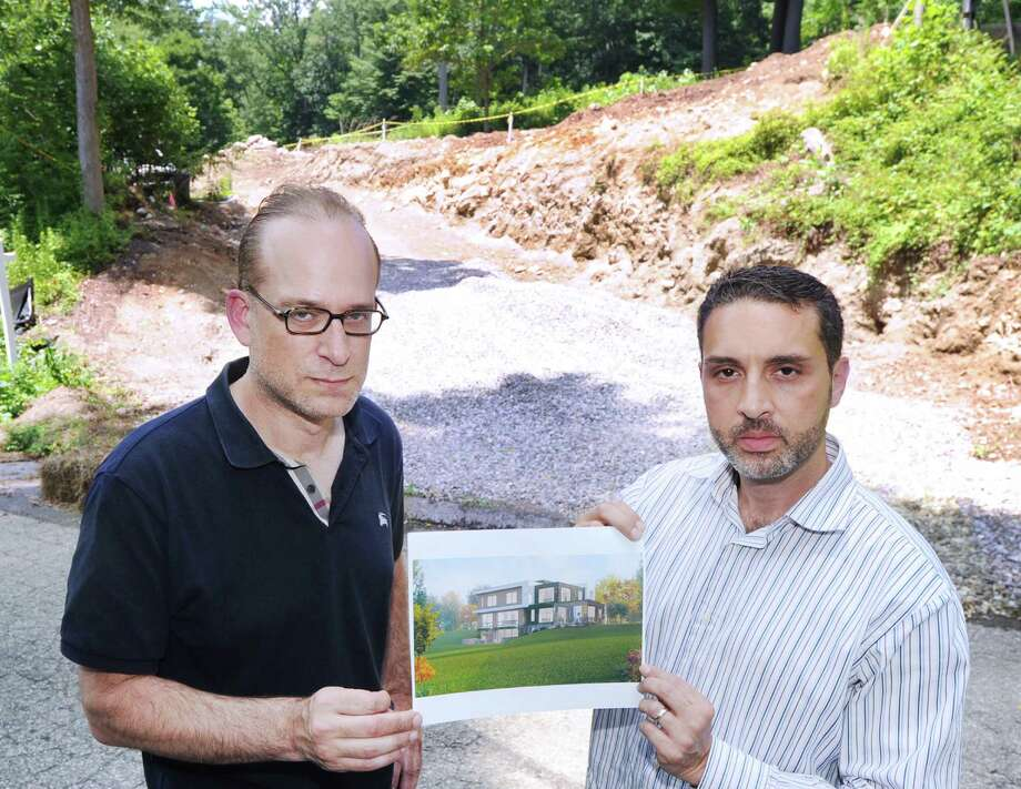 Construction Management Group executives, Michael Block, left, and Salvatore Zarrella, at the site of their new Passive House construction on Campbell Drive in Stamford, Conn., Wednesday, July 6, 2016. A passive home is a highly energy efficient building standard pioneered in Austria 25 years ago that reduces energy consumption in homes by 75 to 90 percent through better insulation, elimination of thermal bridges by using unconventional materials, and air tight construction. Photo: Bob Luckey Jr. / Hearst Connecticut Media / Greenwich Time