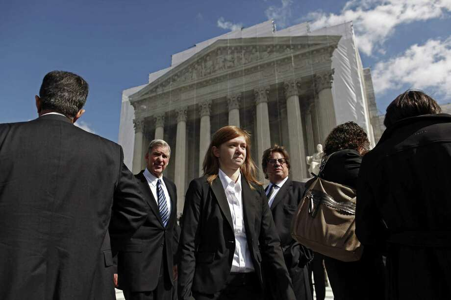 FILE -- Abigail Fisher waits in front of the Supreme Court to speak to the media after the Justices heard the arguments surrounding the affirmative action case Fisher v. University of Texas, in Washington, Oct. 10, 2012. The Supreme Court on Thursday June 23, 2016 rejected a challenge, by a 4-3 vote, to a race-conscious admissions program at the University of Texas at Austin, handing supporters of affirmative action a major victory. (Luke Sharrett/The New York Times) Photo: LUKE SHARRETT, STR / NYT / NYTNS