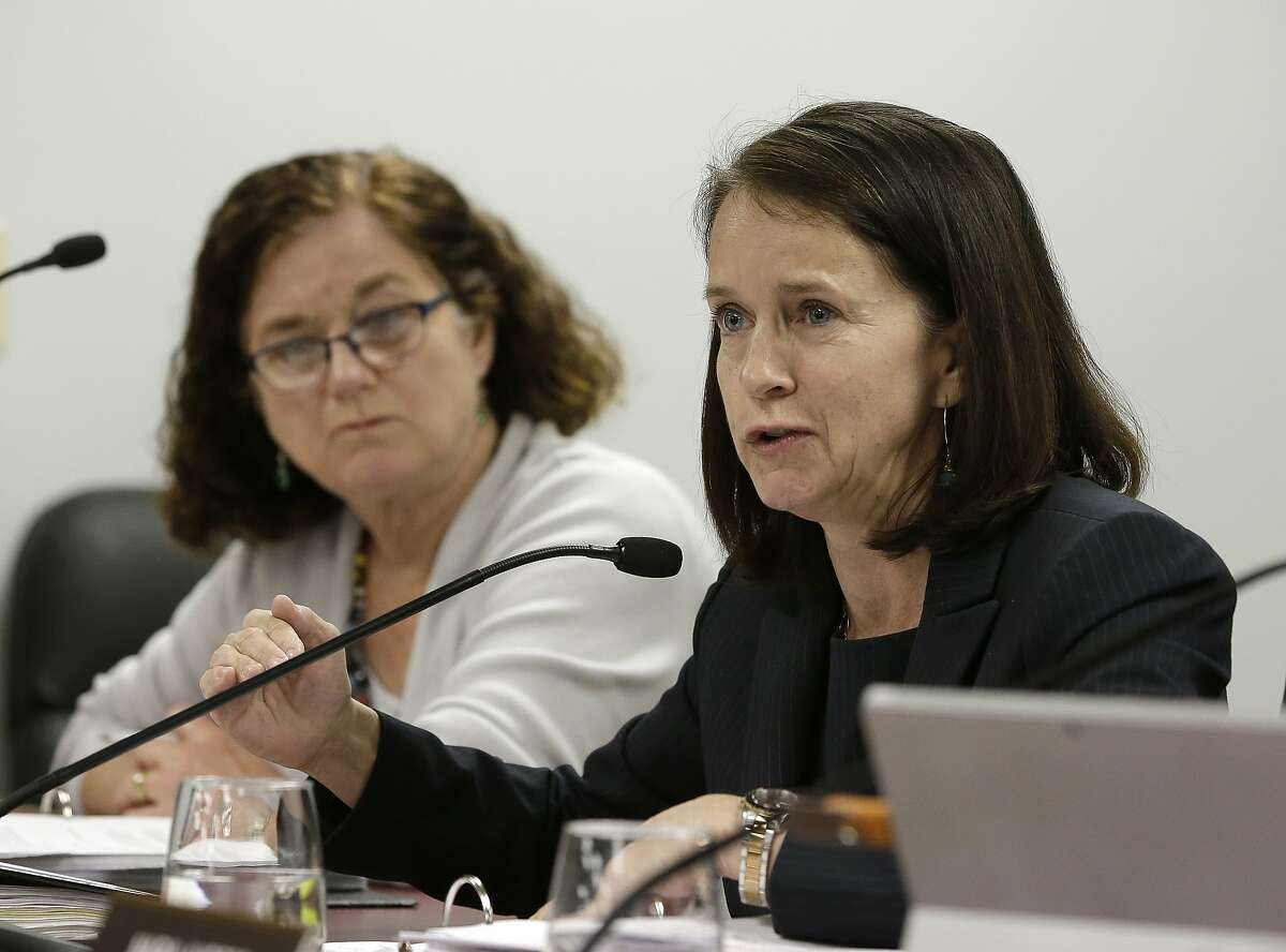 Jodi Remke, right, chairwoman of the Fair Political Practices Commission, discusses a proposed rule change to curb unreported lobbying, as commission member Patricia Wynne, left, looks on Thursday, March 17, 2016, in Sacramento, Calif. The commission voted 3-1 to revise the rule that allows some people to lobby state officials but duck reporting requirements. (AP Photo/Rich Pedroncelli)
