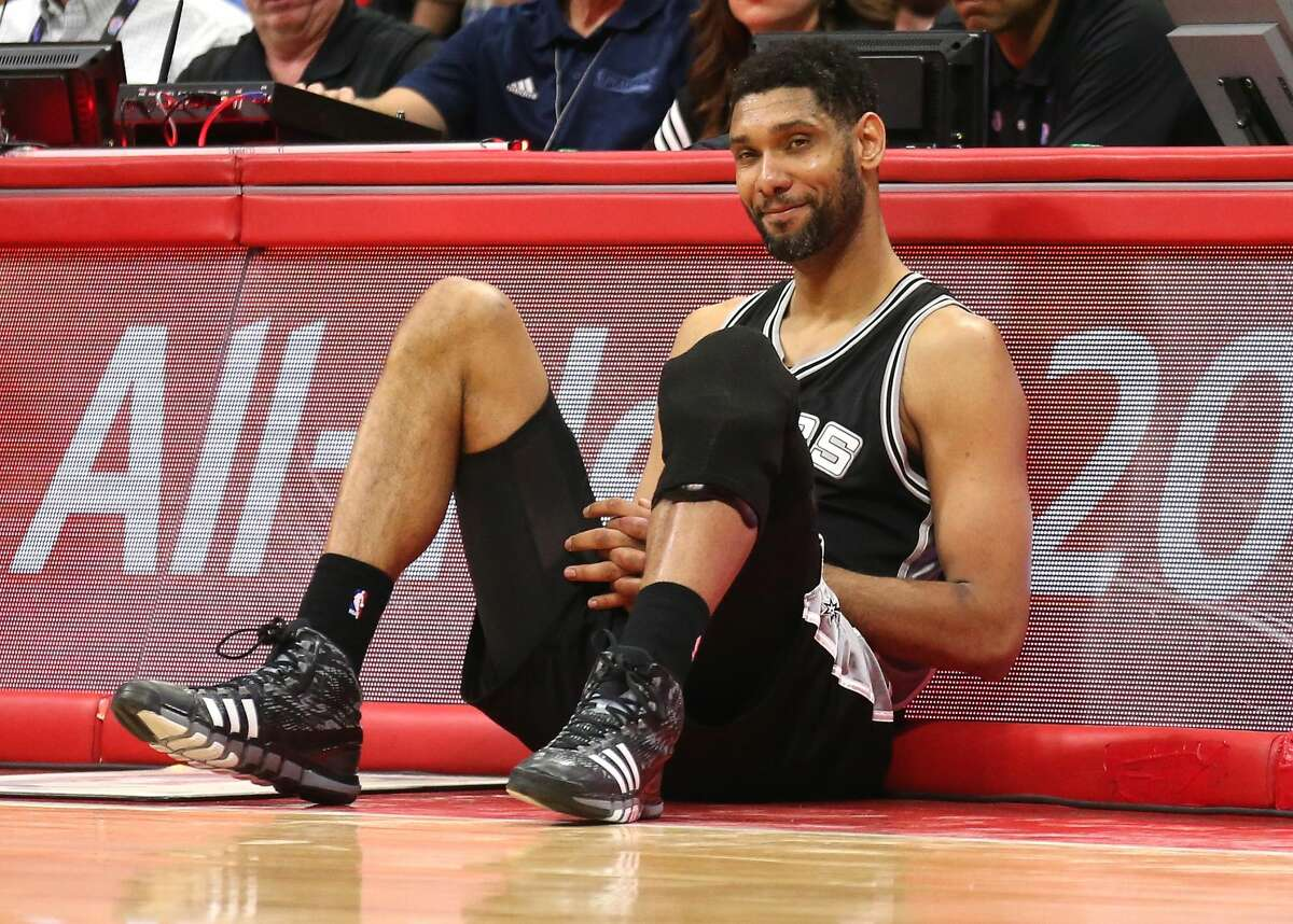 LOS ANGELES, CA - MAY 02: Tim Duncan #21 of the San Antonio Spurs as he sits by the scorer's table waiting to enter the game against the Los Angeles Clippers during Game Seven of the Western Conference quarterfinals of the 2015 NBA Playoffs at Staples Center on May 2, 2015 in Los Angeles, California. The Clippers won 111-109 to win the series four games to three. NOTE TO USER: User expressly acknowledges and agrees that, by downloading and or using this photograph, User is consenting to the terms and conditions of the Getty Images License Agreement. (Photo by Stephen Dunn/Getty Images)