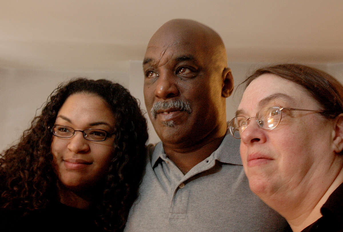 TIMES UNION STAFF PHOTO BY SKIP DICKSTEIN The Coleman family from left to right: Cecily age 25, Jay and Alison Coleman stand up for a family photo in their home in Albany, New York, Thursday January 12, 2006, after getting Jay back from a 25 year jail term last fall. Cecily, grew up visiting her dad in jail after he was incarcerated 25 years ago for robbery.