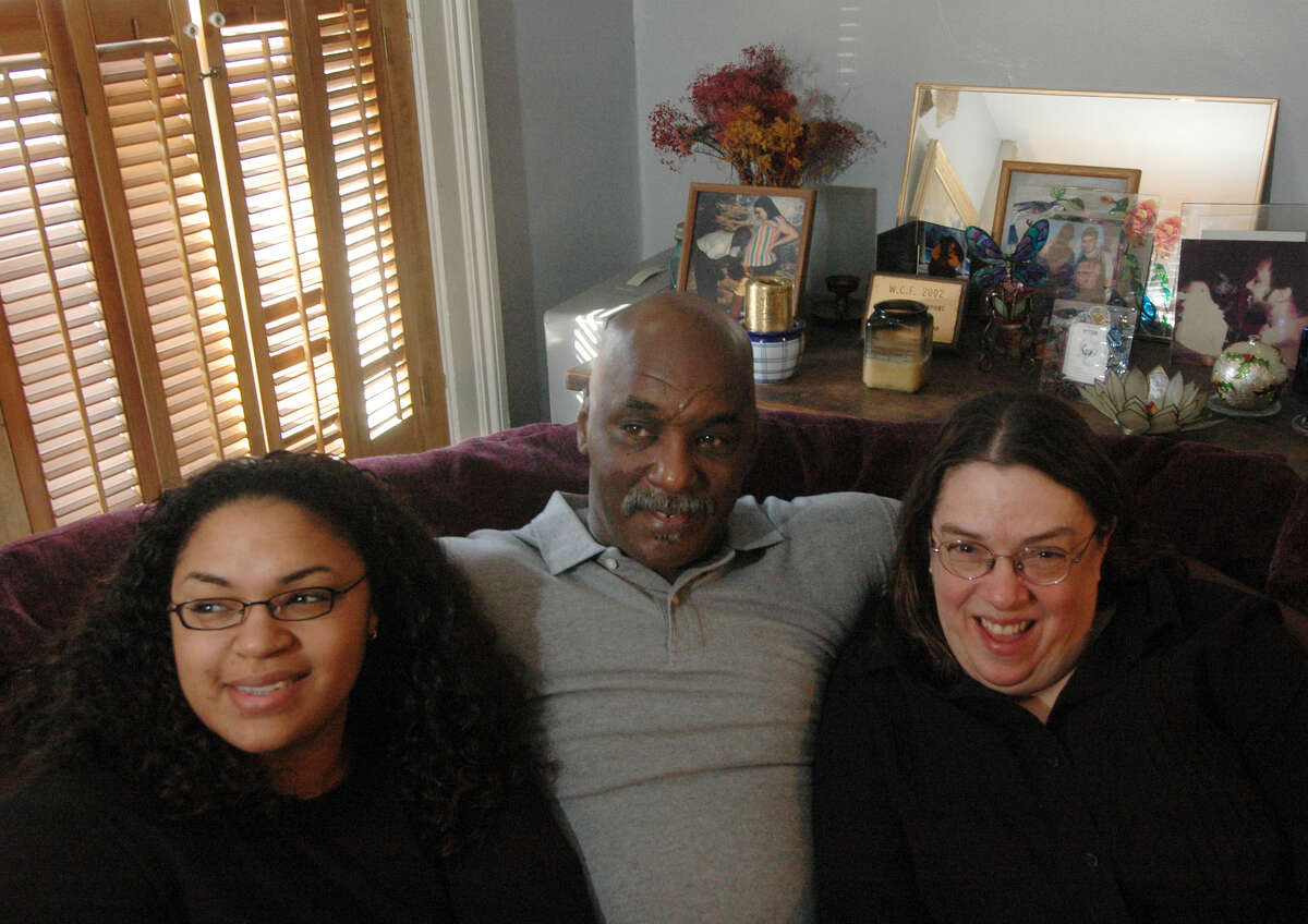 TIMES UNION STAFF PHOTO BY SKIP DICKSTEIN - The Coleman family from left to right: Cecily age 25, Jay, and Alison Coleman stand up for a family photo in their home in Albany, New York, Thursday January 12, 2006, after getting Jay back from a 25 year jail term last fall. Cecily, grew up visiting her dad in jail after he was incarcerated 25 years ago for robbery.