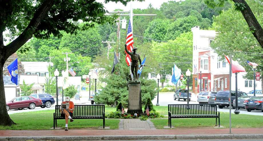"The doughboy statue in Bethel's P.T. Barnum Square park will be removed this month to be refurbished and returned in the fall. Monday, July 11, 2016, in Bethel, Conn.  ""Spirit of the American Doughboy."" is by sculptor E.M. Viquesney. Photo: H John Voorhees III / Hearst Connecticut Media / The News-Times"