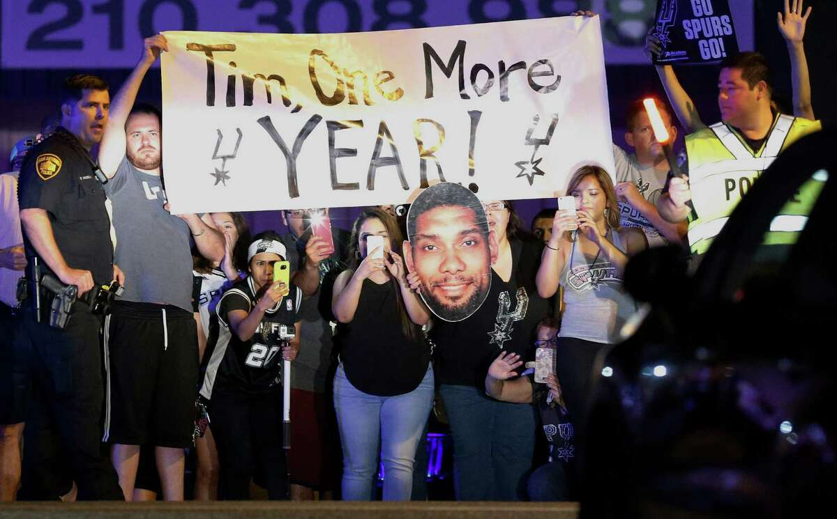 Fans show their support for Tim Duncan as the San Antonio Spurs return home after losing in Game 6 of the Western Conference semifinals to the Oklahoma City Thunder on Friday, May 13, 2016. Hundreds of fans came out to the private terminal as a show of support for the team and especially for Tim Duncan who may be retiring after playing his entire career in the NBA with the Spurs for 19 seasons. (Kin Man Hui/San Antonio Express-News)