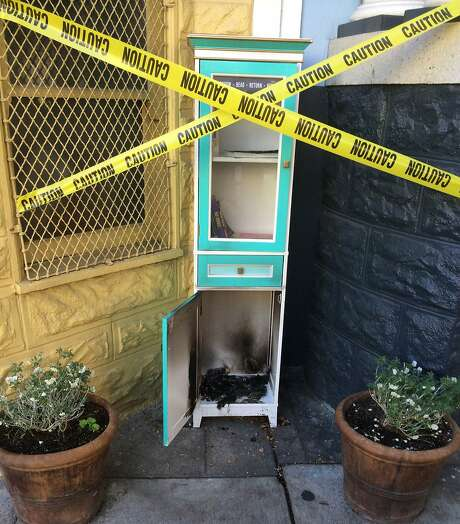 Scorch marks can be seen after a vandal set fire to the Little Free Library on Noe Street in S.F. Photo: Peter Kupfer