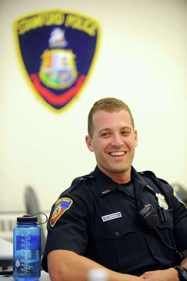 Stamford police trainee Dan Kokkoros, 29, smiles inside their classroom on Thursday, June 30, 2016. Photo: Michael Cummo / Hearst Connecticut Media / Stamford Advocate