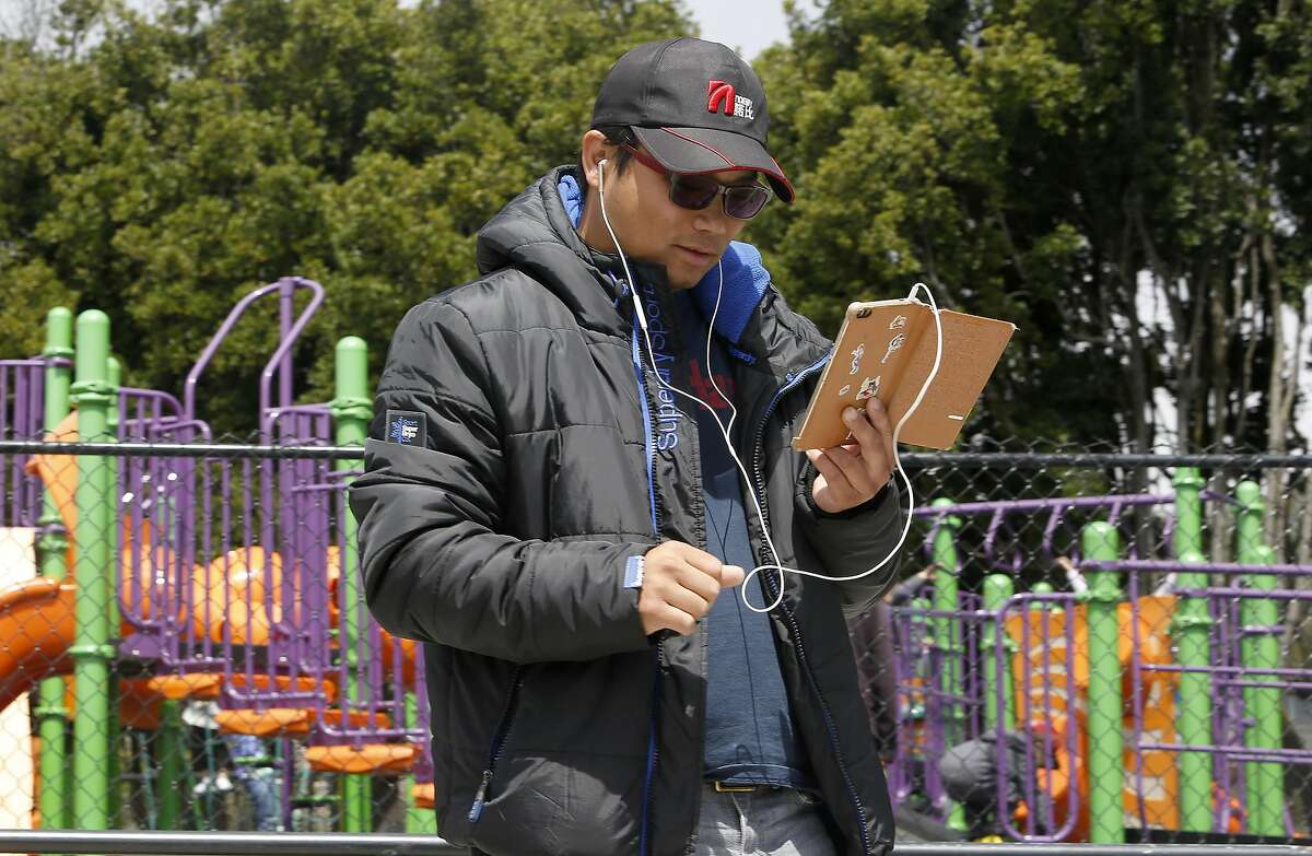 Wesley Huang , 30 years old, plays Pokemon Go at Balboa Park on Monday, July 11, 2016 in San Francisco, Calif.