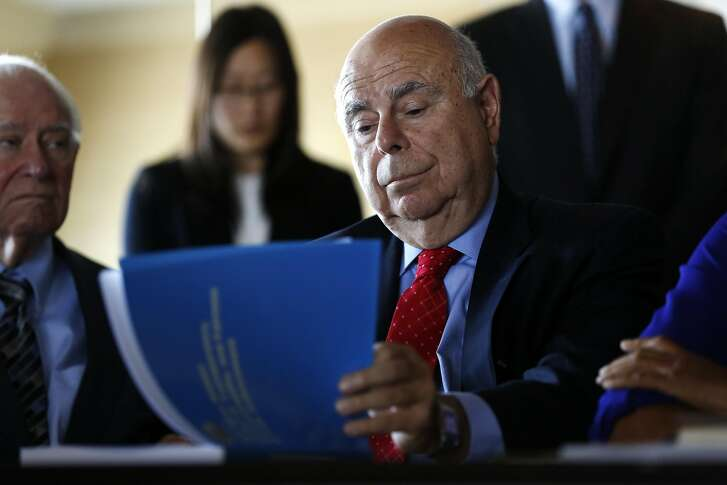 The Hon. Dickran Tevrizian looks through a copy of the Blue Ribbon Panel report on the San Francisco Police Department during a press conference announcing its release in San Francisco, California, on Monday, July 11, 2016.