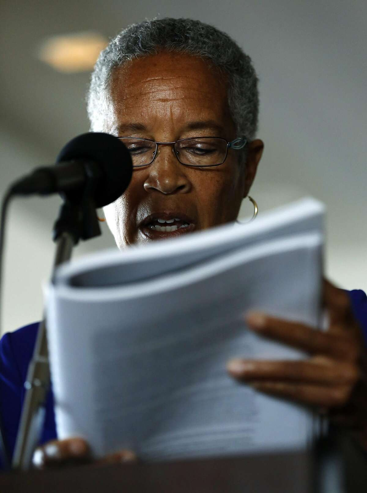 The Hon. LaDoris Cordell reads from a copy of the Blue Ribbon Panel's report on the San Francisco Police Conference at a press conference announcing its release in San Francisco, California, on Monday, July 11, 2016.