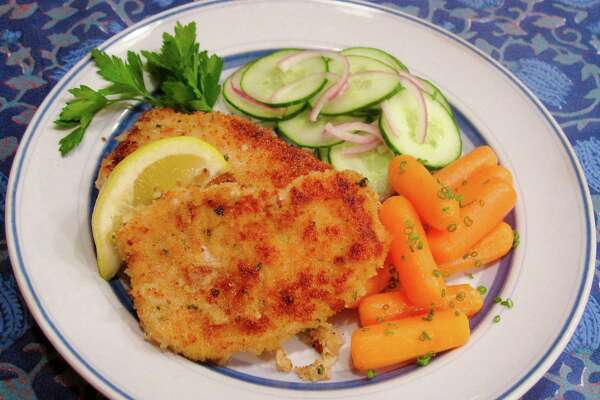 Crispy Buttermilk-Soaked Pork Chops are coated in a mixture of panko and seasoned bread crumbs.
