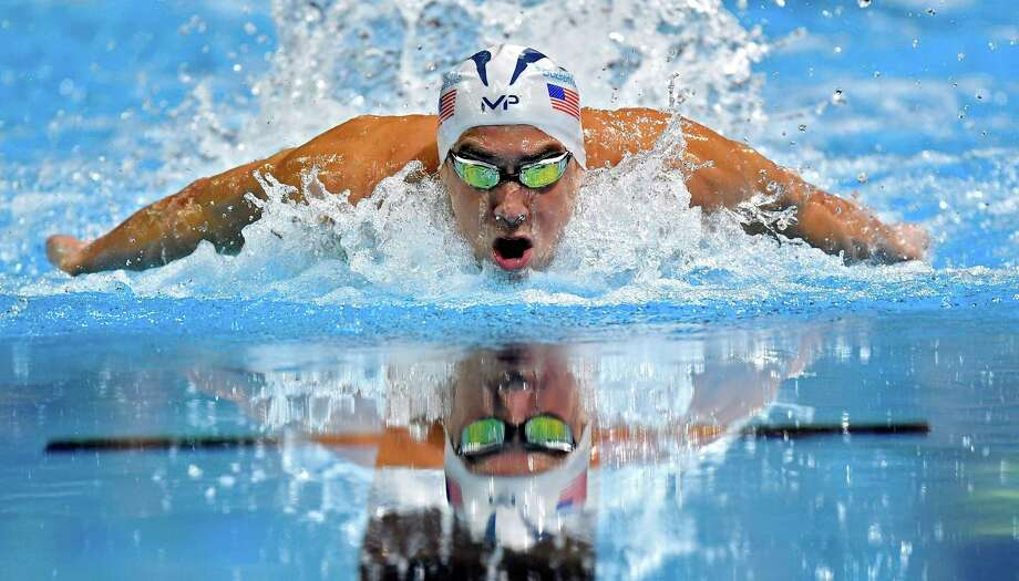 Michael Phelps swims in the men's 100-meter butterfly final at the U.S. Olympic swimming trials, Saturday, July 2, 2016, in Omaha, Neb. Phelps won the race. (AP Photo/Mark J. Terrill) Photo: Mark J. Terrill / Associated Press / Copyright 2016 The Associated Press. All rights reserved. This material may not be published, broadcast, rewritten or redistribu
