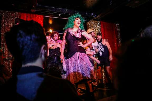 Drag performers dance on stage during a show at The Stud Bar in San Francisco, California, on Friday, July 8, 2016.