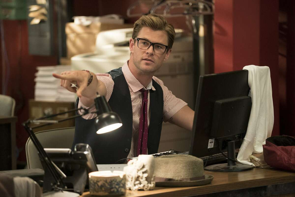 """This image released by Sony Pictures shows Chris Hemsworth in a scene from """"Ghostbusters,"""" opening nationwide on July 15. (Hopper Stone/Columbia Pictures/Sony Pictures via AP)"""