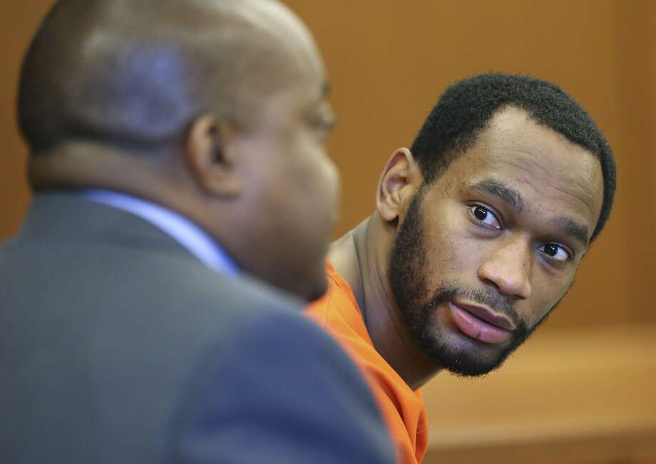 This April 22, 2016 photo shows former Dallas Cowboys running back Joseph Randle looking towards his attorney after Sedgwick County district court judge Kevin O'Conner denied Randle's request for a bond reduction. Randle has been charged with assaulting a fellow inmate in a Kansas jail. Photo: Travis Heying, Associated Press