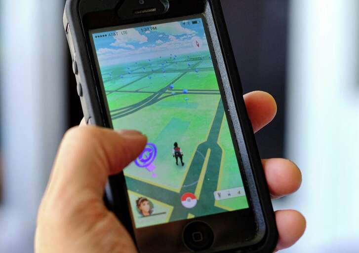 Pokémon Go players search for digital monsters using a smartphone app.