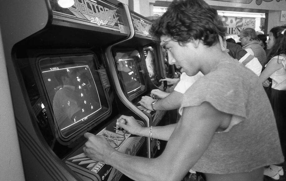 "July 8, 1982: A Bay Area arcade debuts the new video game ""Robotron."" Phil Lobsinger is at the controls. Photo: Eric Luse, The Chronicle"