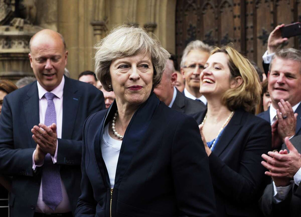 Theresa May is applauded by Conservative Party parliament members in London on Monday. May will replace Prime Minister David Cameron on Wednesday.