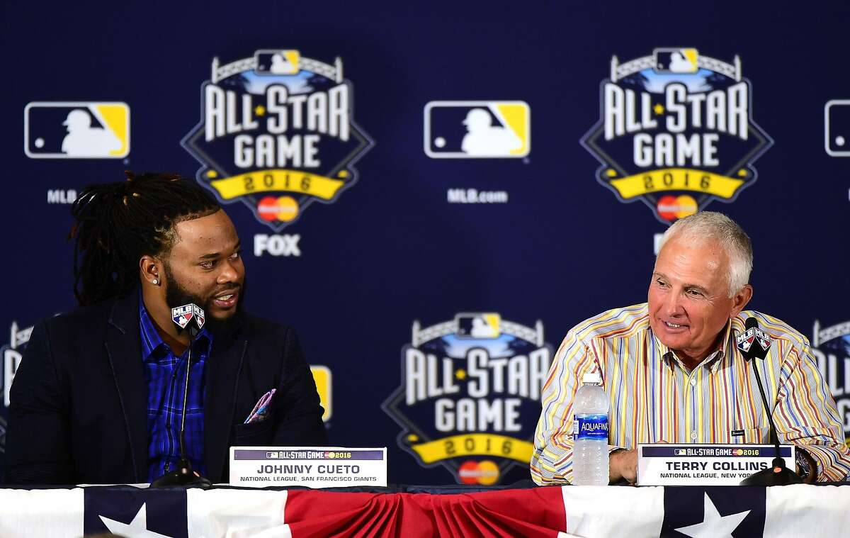 Manager Terry Collins of the New York Mets and National League starting pitcher Johnny Cueto #47 of the San Francisco Giants speak to media during Media Availability for the 87th Annual MLB All-Star game at the Manchester Grand Hyatt on July 11, 2016 in San Diego, California.