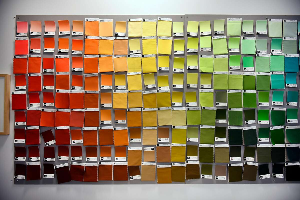 Color swatches are seen on a wall in the Quality Assurance lab at The North Face's headquarters in Alameda, Calif., on Monday, July 11, 2016.