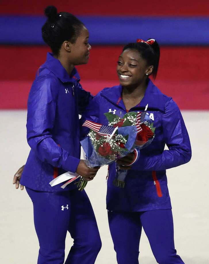 """Simone Biles, right, enjoys the bond she's formed with U.S. teammates like Gab-rielle Douglas, saying """"we're blessed to have each other to go along for the ride."""""""