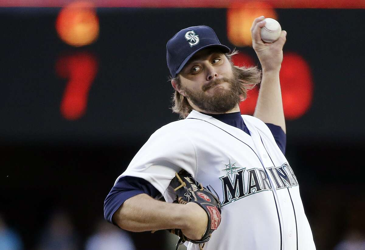 FILE - In this May 10, 2016, file photo, Seattle Mariners starting pitcher Wade Miley throws against the Tampa Bay Rays during the first inning of a baseball game in Seattle. Miley hears the talk about lifting the bottom of the strike zone in an effort to spark offense and says there's been too much tinkering.