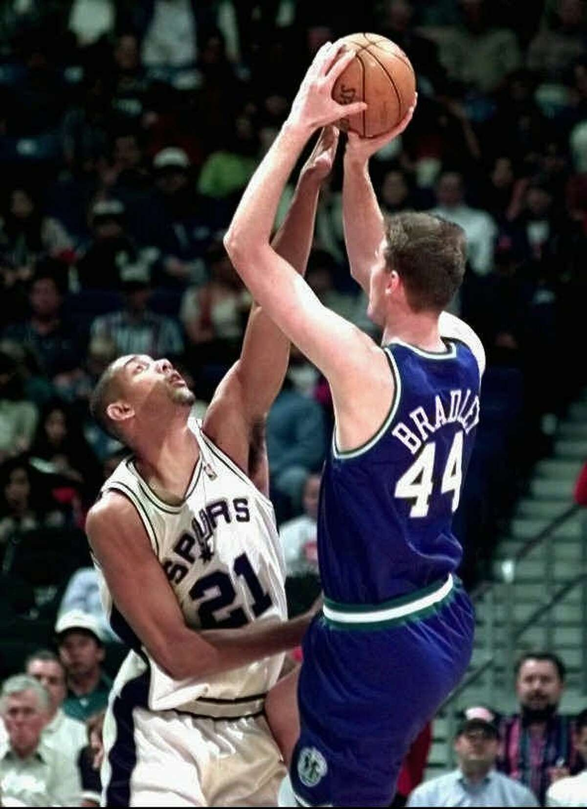 San Antonio Spurs Tim Duncan (21) blocks the attempted shot by Dallas Mavericks center Shawn Bradley (44) during first quarter action of their preseason game at the Alamodome in San Antonio , Wednesday Oct. 22, 1997. (Express-News,Doug Sehres)