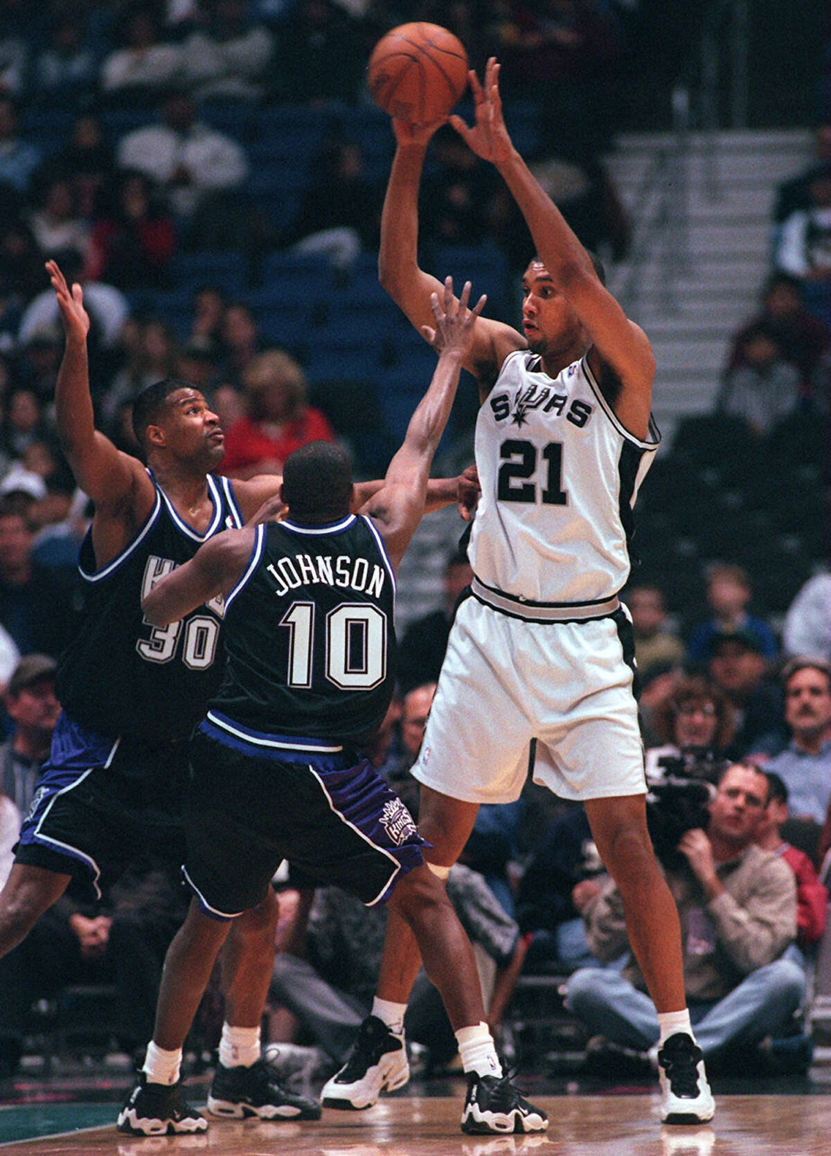 San Antonio Spurs' Tim Duncan (21) is bothered by Sacramento Kings' Anthony Johnson (10) and (30) Billy Owens during the 1st quarter action of play, Thursday, March 12, 1998 at the Alamodome in San Antonio, Texas. (Joey Garcia,San Antonio Express-News)