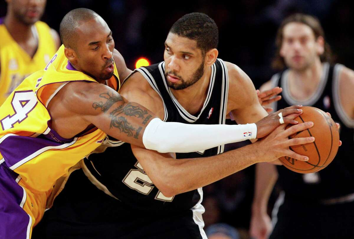 San Antonio Spurs Tim Duncan keeps the ball away from Los Angeles Lakers Kobe Bryant during the first half of game 2 of the NBA Western Conference Finals at Staples Center on Friday, May 23, 2008. JERRY LARA/glara@express-news.net