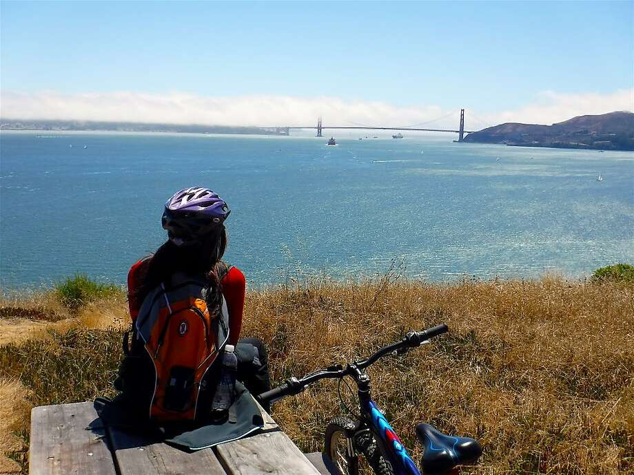 On 5-mile Perimeter Road at Angel Island, the Bay Area's most popular bike ride, Denese Stienstra stops at picnic bench lookout to take in the view of ships heading out the Golden Gate Photo: Tom Stienstra, Tom Stienstra / The Chronicle