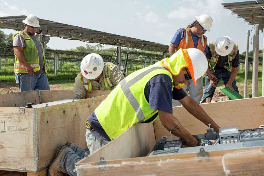 The investment tax credits were extended in 2015 and will be reduced gradually through 2023, when only commercial and utility-scale projects will receive a reduced tax credit. Photo: Ray Whitehouse /for The San Antonio Express-New