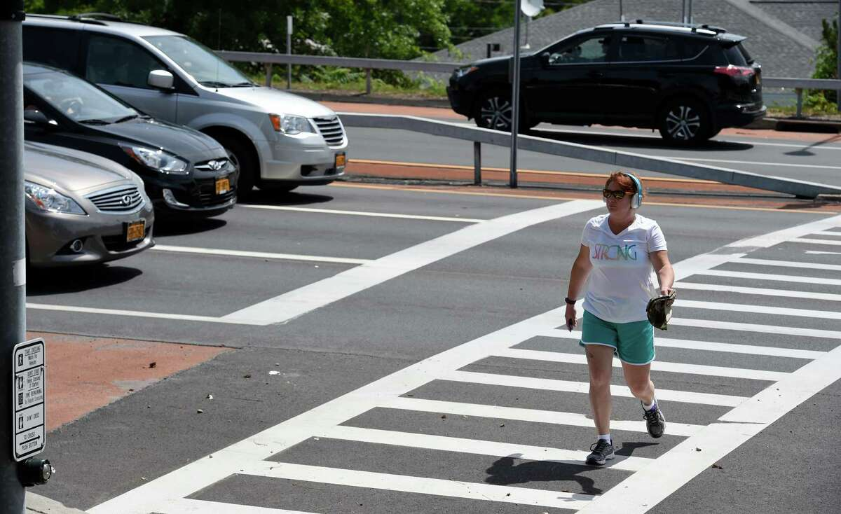 A pedestrian walks across Cohoes Boulevard on Monday, July 11, 2016, in Cohoes, N.Y. (Skip Dickstein/Times Union)