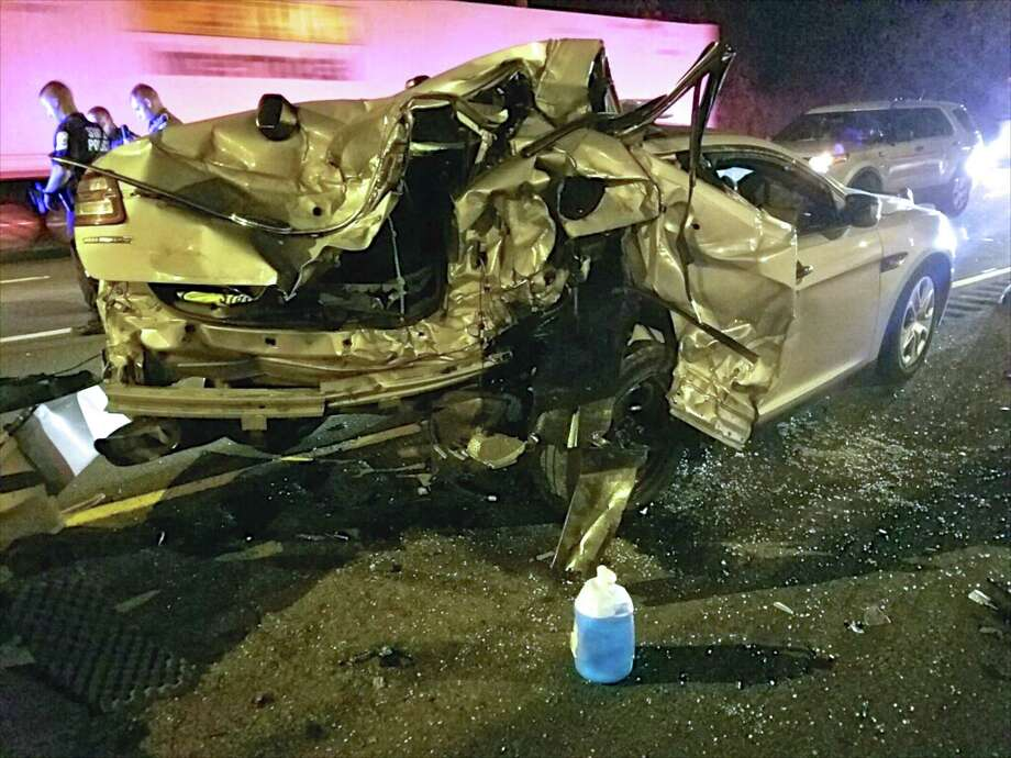 Connecticut State Troopers from Troop G-Bridgeport arrested a New York man following the pursuit of a tow truck on I-95. The tow truck operator intentionally rammed an unoccupied state police cruiser causing extensive damage. July 9, 2016. Photo: Contributed Photo / The News-Times Contributed