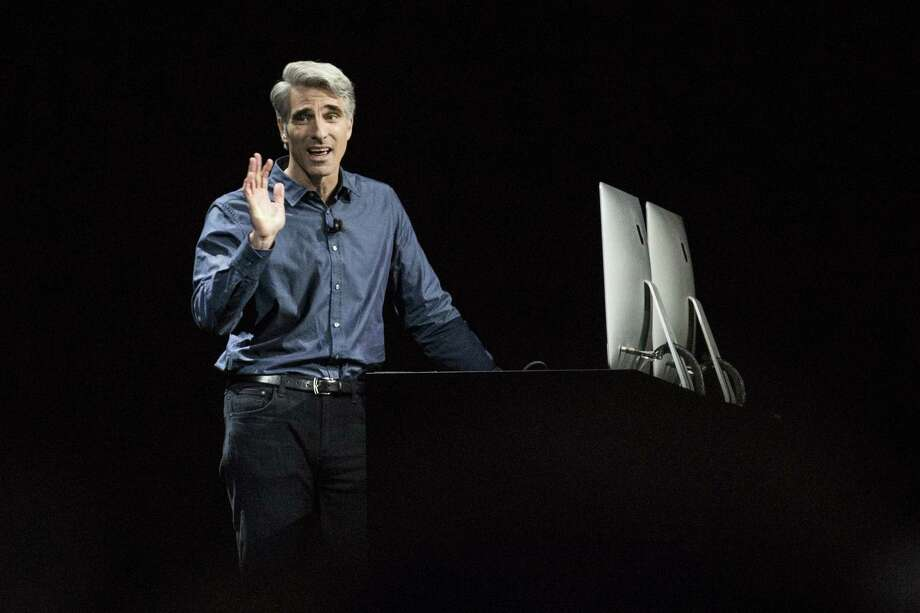 Craig Federighi, an Apple vice president, shows the macOS Sierra software in San Francisco.  Photo: Andrew Burton, Stringer / 2016 Getty Images