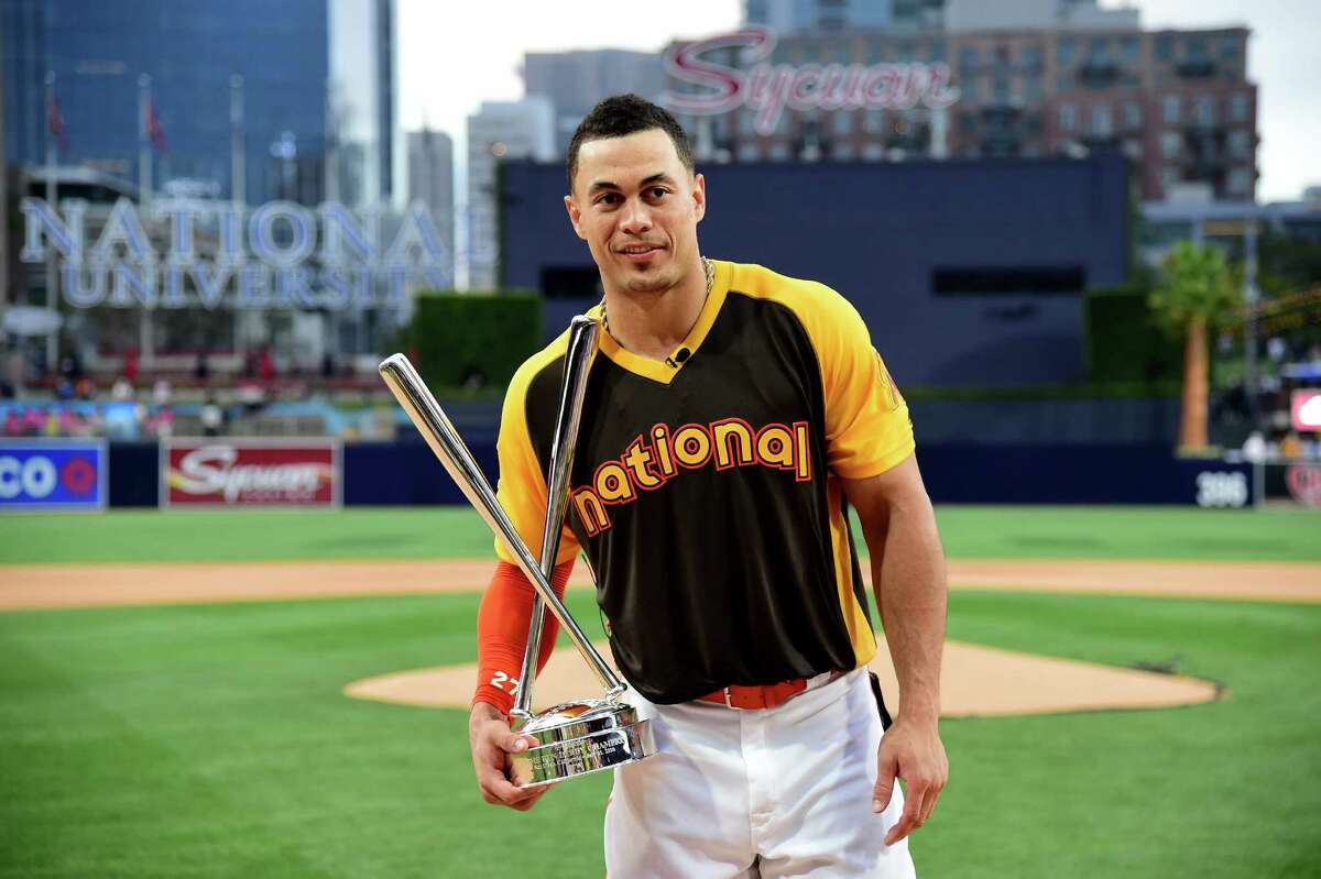 SAN DIEGO, CA - JULY 11: Giancarlo Stanton of the Miami Marlins celebrates after winning the T-Mobile Home Run Derby at PETCO Park on July 11, 2016 in San Diego, California.