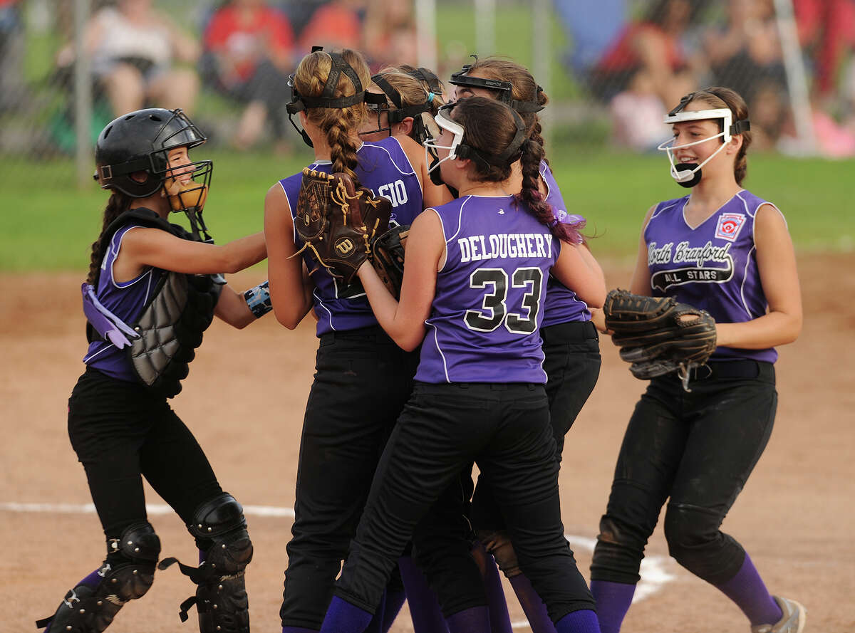 North Branford players celebrate after the final out of their 3-0 victory over Monroe in the Section 1 Little League softball championship game at Unity Park in Trumbull, Conn. on Monday, July 11, 2016.